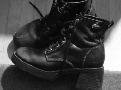 Worn boots in black and white